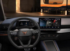Cupra born interior view of the dashboard with steering wheel and infotainment screen